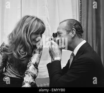 Actor David Niven photographs French actress Francoise Dorleac shortly before they leaft for Lebanon to film 'Passport - Stock Photo