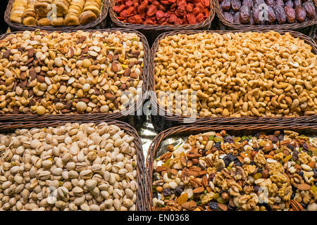 Nuts and cereals seen at the Boqueria market in Barcelona - Stock Photo
