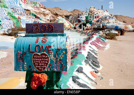 Leonard Knight painted a man-made mountain and called it Salvation Mountain. It's off the grid Slab City near Niland - Stock Photo