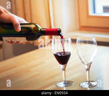 red wine and two glasses on the table - Stock Photo