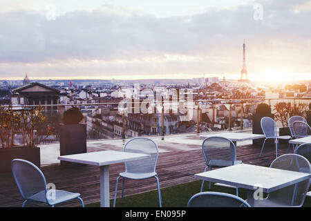 sunny terrace of restaurant in Paris with panoramic view on Eiffel tower, France - Stock Photo