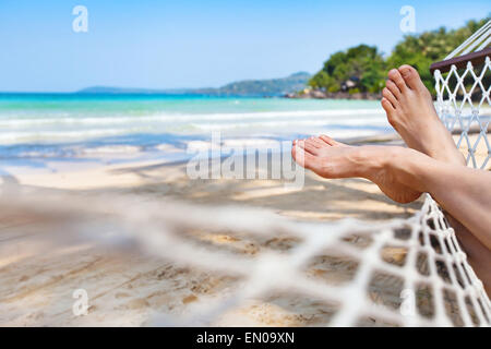 relaxing in hammock on the beautiful paradise beach - Stock Photo