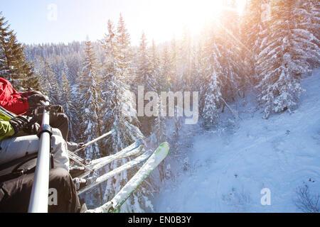 family sitting in ski lift - Stock Photo