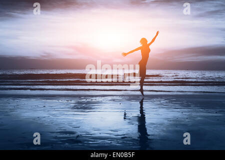 healthy life, silhouette of carefree woman on the beach - Stock Photo