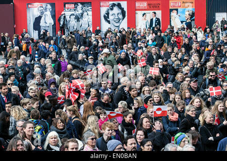 Copenhagen, Denmark, April16th, 2015. Spectators at Copenhagen City Hall Square waiting for Queen Margrethe to appear - Stock Photo