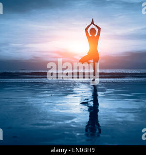 wellness concept, beautiful silhouette of woman practicing yoga - Stock Photo