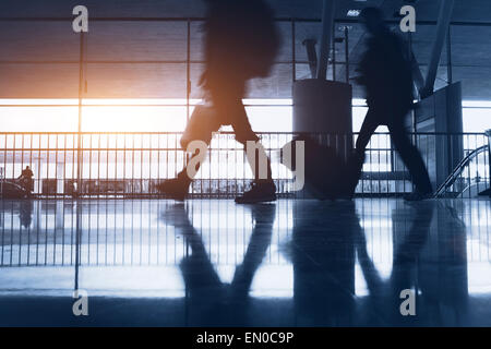 abstract airport background with walking commuters - Stock Photo