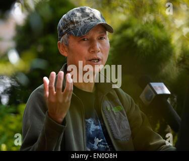 Washington, DC, USA. 24th Apr, 2015. China's wildlife photographer Xi Zhinong speaks at an interview with Xinhua - Stock Photo