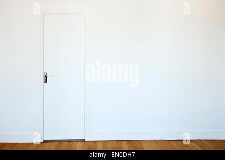 white door on white wall, real estate background - Stock Photo