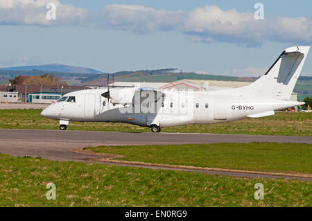 Dornier 328-110 34 seater short haul airliner of Loganair working from Inverness airport.  SCO 9693. - Stock Photo