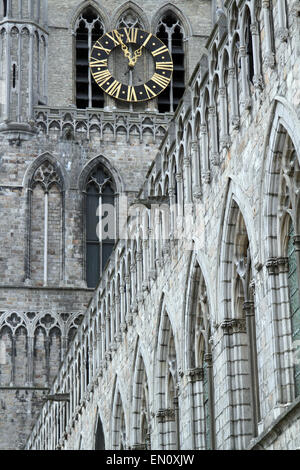 The clock tower on the medieval Cloth Hall (Lakenhalle) in the centre of Ypres, Belgium on 22 April 2015 - Stock Photo