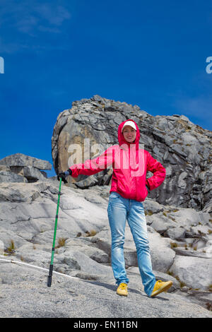 Hiking young woman in mountains - Stock Photo