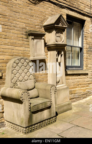 UK, England, Yorkshire, Bradford, Little Germany, grandad's clock and chair sculpture by Timothy Shutter - Stock Photo