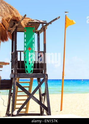 Lifeguard hut and yellow flag on caribbean beach - Stock Photo