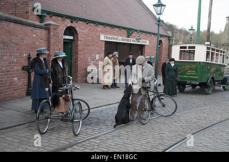 Group of people dressed in period costume at the tram stop in Beamish Open Air Museum, Co. Durham. - Stock Photo
