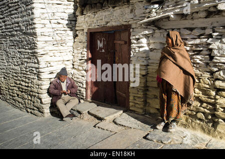 local people  on the street, Marpha village, Annapurna circuit trek, Mustang, Nepal - Stock Photo
