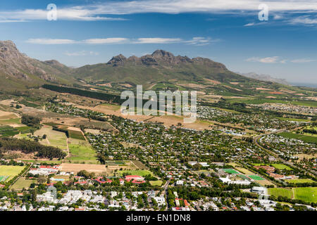 Aerial view of parts of the town of Stellenbosch and the Hottentots Holland Mountains in the Western Cape. - Stock Photo
