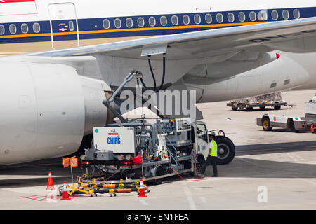 Passenger jet airplane fuel supply truck, airport service, refueling - Stock Photo