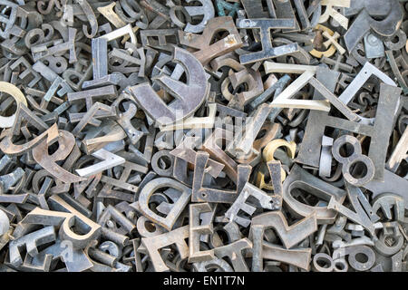 A pile of different iron letters and numbers  seen at a flee market - Stock Photo
