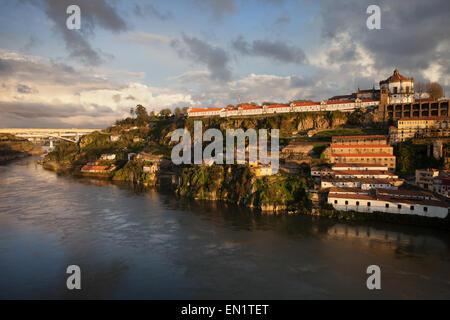 Vila Nova de Gaia in Portugal at sunset along Douro river. - Stock Photo
