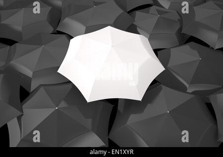 white umbrella in the middle of several black umbrellas - Stock Photo