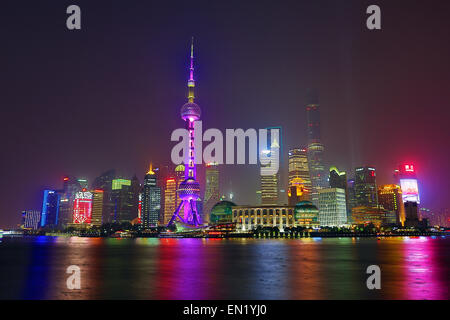 General view of the Pudong city skyline in Shanghai at night with the Oriental Pearl TV Tower, Shanghai, China - Stock Photo