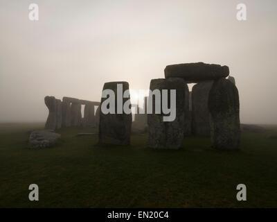 Dawn and Mist at Stonehenge, prehistoric monument of standing stones, Wiltshire, England. UNESCO World Heritage - Stock Photo