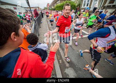 London, UK. 26th April, 2015. 35th London Marathon passes through Deptford in south east London. Credit:  Guy Corbishley/Alamy - Stock Photo