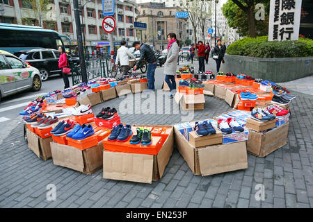 Selling shoes in the Street, Shanghai, China - Stock Photo
