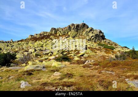 Rocky landscape. Man at the top of the Violik peak (Labski Szczyt) in the Karkonosze Mountains National Park in - Stock Photo