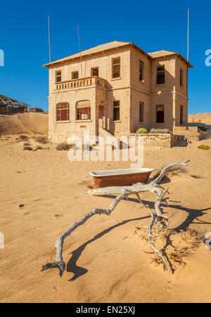 A deserted house in Kolmanskop, a former diamond town in Namibia. - Stock Photo