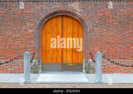 Door on the brick wall - Stock Photo