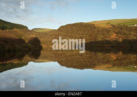 A colour image of the morning refection into Garreg Ddu reservoir in the Elan Valley - Stock Photo