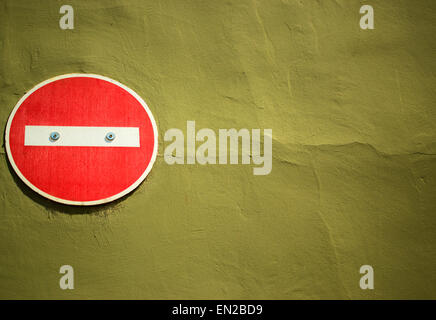 No entry sign attached to yellow brown painted wall - Stock Photo