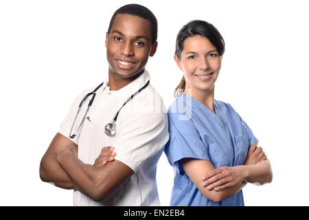 African doctor with a smiling happy Caucasian nurse or medical colleague standing back to back with folded arms - Stock Photo