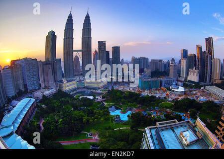 Petronas Twin Towers skyscrapers at sunset, KLCC, Kuala Lumpur, Malaysia - Stock Photo