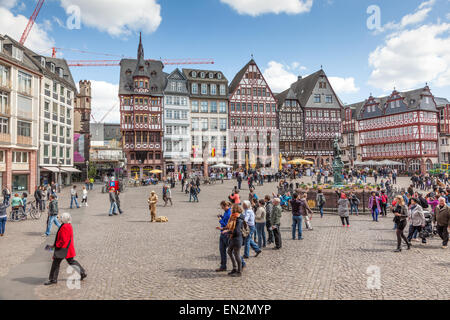 People on Roemerberg square in the historic center of Frankfurt Main, Germany - Stock Photo