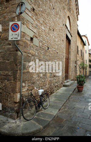A bike on a stone street in Florence, Italy - Stock Photo