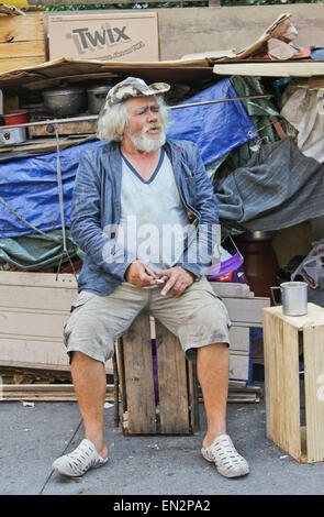 SAO PAULO, BRAZIL - FEBRUARY 08, 2015: An unidentified homeless with his house and things living at the famous Paulista - Stock Photo