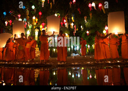 CHIANG MAI, THAILAND - NOVEMBER 07, 2014: Buddhist monks launch sky lanterns at the Yee Peng festival of lights - Stock Photo