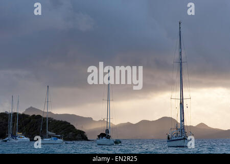 Sailboats anchored for the evening, Tobago Cays Marine Park, Grenadines - Stock Photo