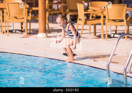 Cute Little Girl Is Ready To Jump Into Swimming Pool Learning How To Stock Photo Royalty Free