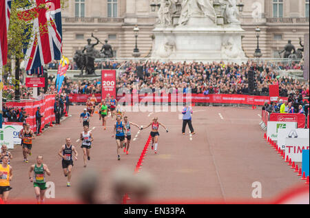 Paula Radcliffe on The Mall as she finishes the Virgin Money London Marathon 2015 - Stock Photo