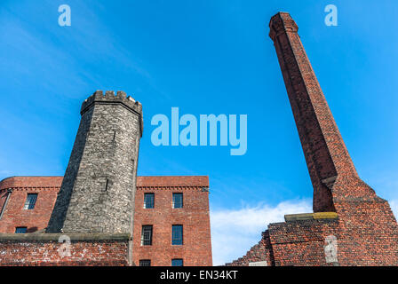 Granite tower and chimney stack at the Stanley Dock warehouse, Liverpool. - Stock Photo