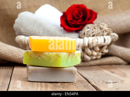 colorful handmade soap bars, on wooden background - Stock Photo