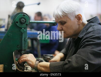 Moscow Region, Russia. 27th Apr, 2015. An employee of Dmitrov training and production enterprise of the All-Russian - Stock Photo