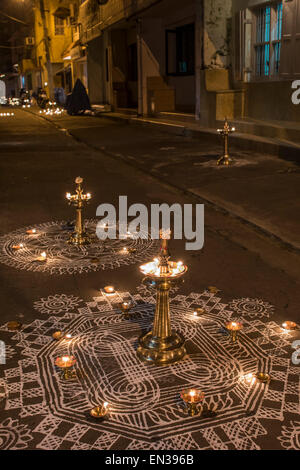 Traditional Rangoli, Kolam or Muggu, decorative pattern, and oil lamps in front of a house entrance, Tamil quarter, - Stock Photo