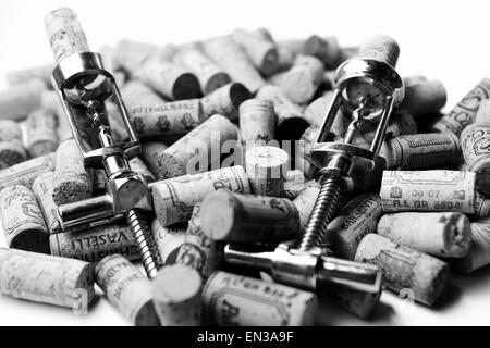 Corkscrews and corks - Stock Photo