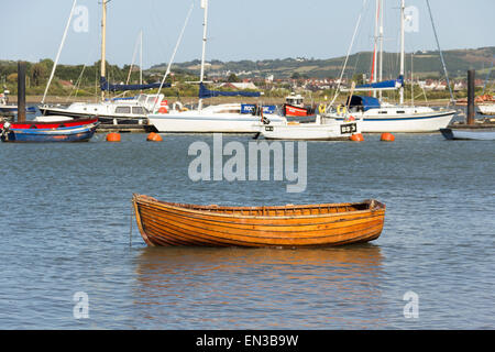 Rowing boat moored near the foreshore of the River Conwy estuary, Conwy, North Wales, with a variety of boats and - Stock Photo