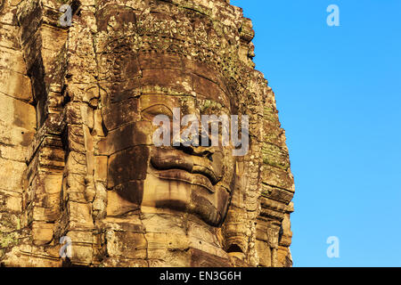 Stone face towers of Bayon Temple at ancient Angkor. Siem Reap, Cambodia - Stock Photo